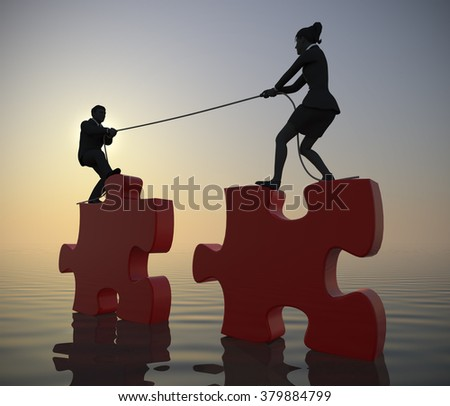 Team pulling giant jigsaw puzzle into position at sea at sunrise. Two executives pull giant jigsaw puzzle pieces into position at sunrise demonstrating teamwork at sea. - stock photo