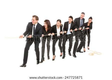 Team pulls together - stock photo