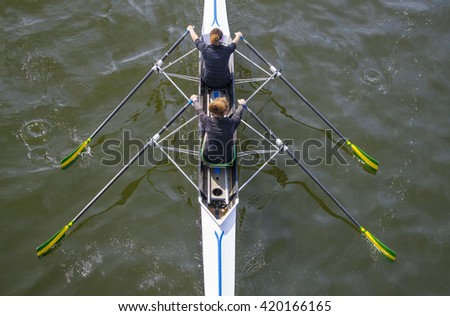 team rowing on a lake in italy - stock photo