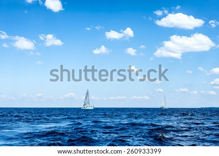 Team sailing on sea space with beautiful sky, copy space.