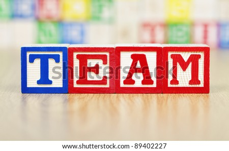 Team Spelled Out in Alphabet Building Blocks - stock photo