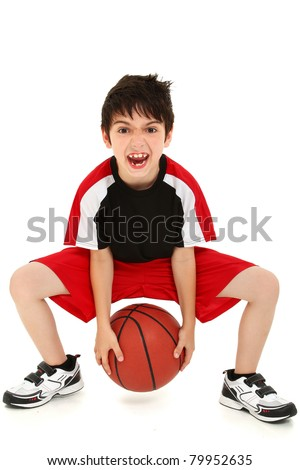 Team sport basketball player child with ball making crazy expressions. - stock photo