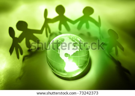 Team united together holding hands. Americas on globe - stock photo
