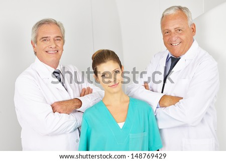 Team with doctors and a MTA in the radiology in a hospital - stock photo