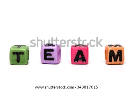 team - word made from multicolored child toy cubes with letters