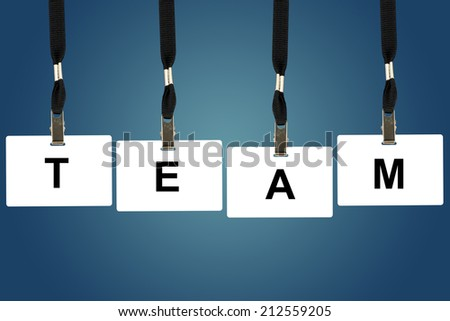 team word on badge with blue background - stock photo