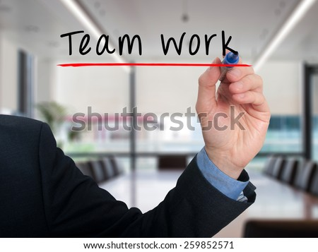 Team work concept businessman hand writing Team work. Office - Stock Photo