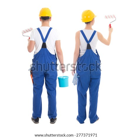 team work concept - man and woman painting wall isolated on white background - stock photo