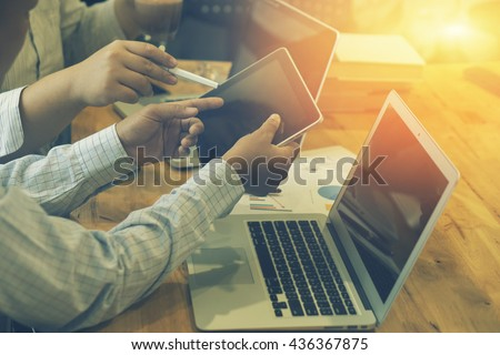 Team work concept,team meeting,man and woman working in the office. collaborative teamwork. Project managers meeting.business crew working with new startup. Analyze plans.selective focus,vintage color - stock photo