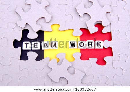 Team work concept with puzzle as a template  - stock photo
