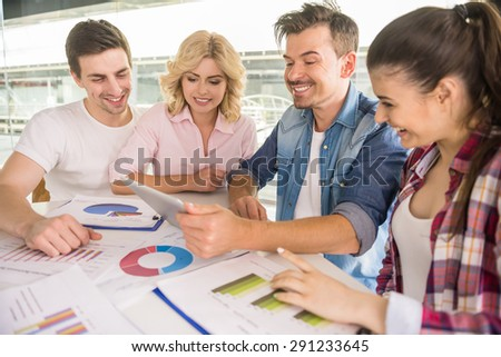 Team work concept. Young colleagues analysing marketing results. - stock photo