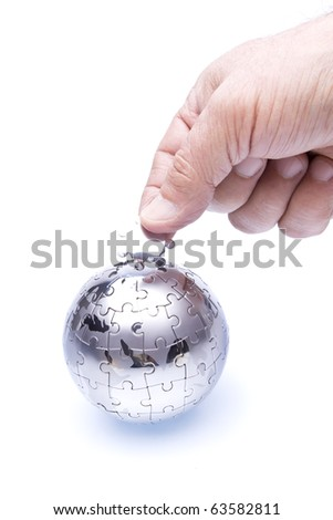 Team work Organization concept with globe puzzle - stock photo