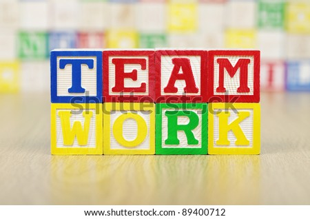 Team Work Spelled Out in Alphabet Building Blocks