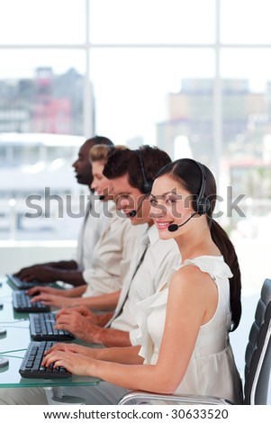 Team working in a call centre - stock photo