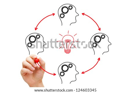 Team working on an idea. If everybody gives a little, it adds up. - stock photo