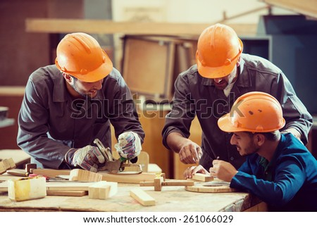 Team working on project in industrial wood factory - stock photo