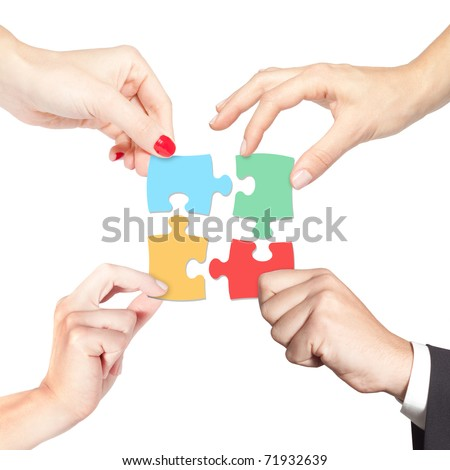 Team working together for a solution (business, strategy, teamwork, partnership, diversity, decision concept) - stock photo