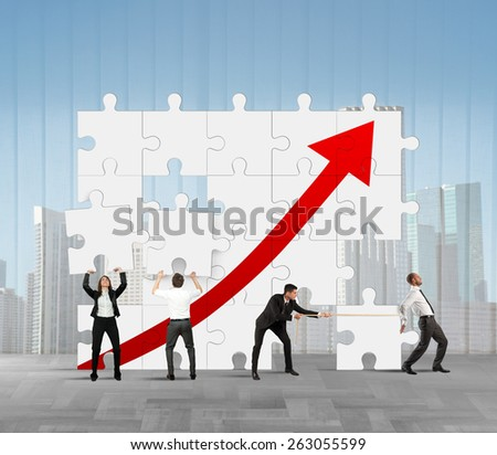 Team works to raise the company statistics - stock photo