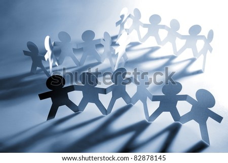 Teams of people holding hands - stock photo