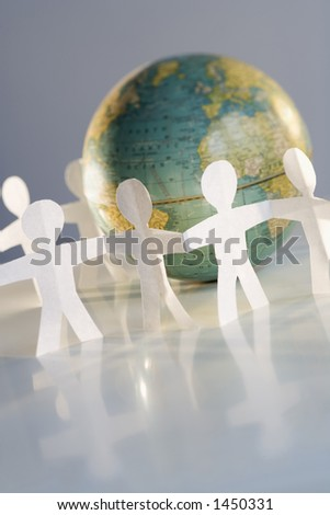 Teamwork and cooperation with group of people around the world - stock photo