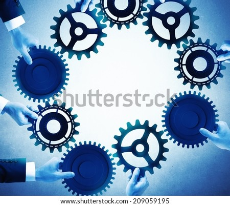 Teamwork and integration concept with businesspeople that holds gears - stock photo