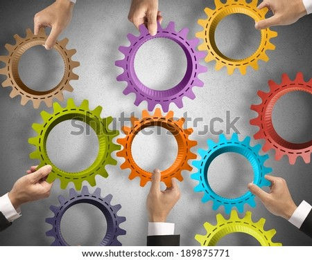 Teamwork and integration concept with gear system - stock photo