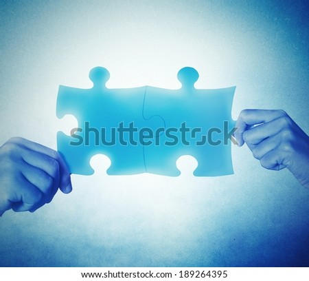Teamwork and integration concept with joining puzzle - stock photo