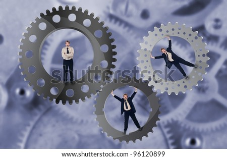 Teamwork and team effort concept with businessman and cogwheels - stock photo