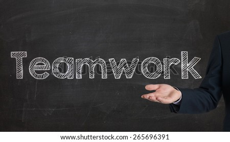 Teamwork - Business Concept presenting on blackboard by hand - stock photo