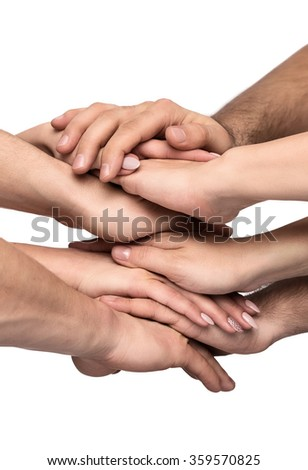 Teamwork, close up of many human hands stacked together isolated on white background - stock photo