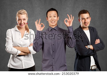 Teamwork concept. Asian man shows OK with both hands - stock photo