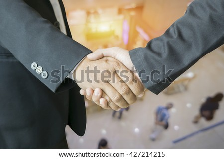 Teamwork concept,Business team standing hands together in the office.Business people joining hands together.People work Teamwork holding hands together.cooperation success business,vintage color - stock photo