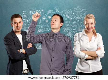 Teamwork concept. Man writing something on glass board with marker