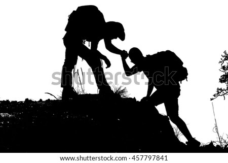 Teamwork concept - Silhouette of Success men mountain climber wi