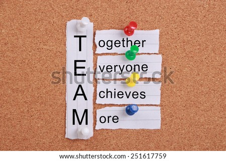 Teamwork concept with some related words pinned on cork board. - stock photo