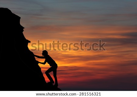 Teamwork couple hiking help each other trust assistance silhouette in mountains, sunset. Teamwork of man and woman hiker helping each other on top of mountain climbing team - stock photo