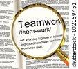Teamwork Definition Magnifier Shows Combined Effort And Cooperation - stock photo