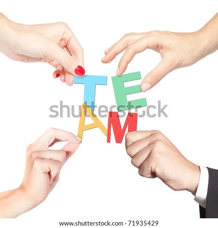 Teamwork forming the word team (teamwork, partnership, diversity, strategy concept) - stock photo