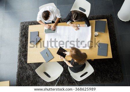 Teamwork in the office - stock photo