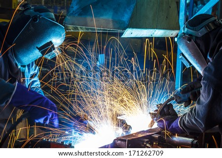 Teamwork in welding steel - stock photo