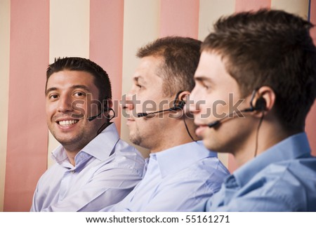Teamwork men of customer service representative,focus on last man that looking and smiling you