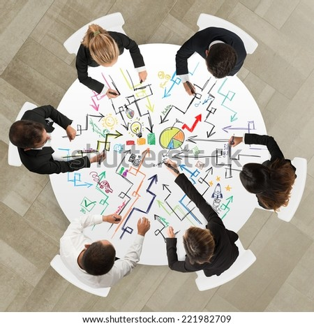 Teamwork of businesspeople that works on a new creative project - stock photo