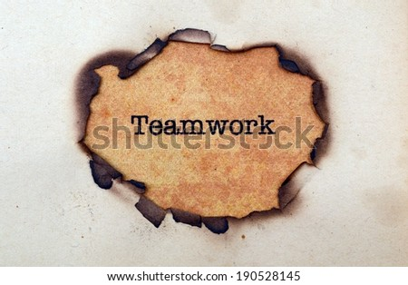 Teamwork paper hole - stock photo