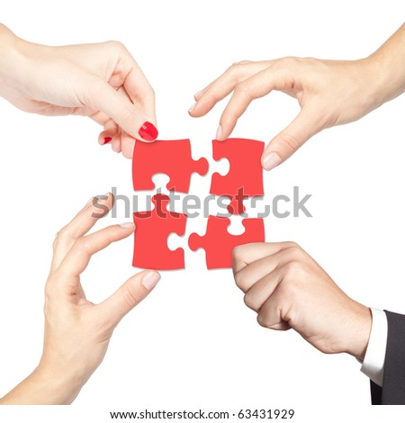 Teamwork solving a puzzle - stock photo
