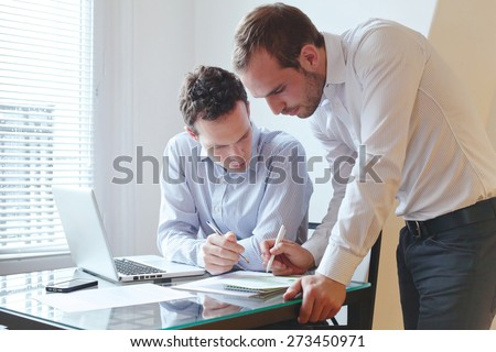 teamwork, two businessmen working in the office - stock photo