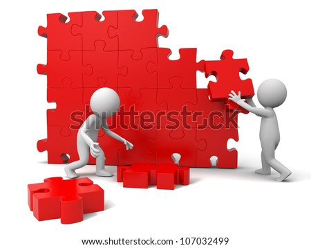 Teamwork/Two people are moving the puzzles