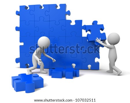 Teamwork/Two people are moving the puzzles - stock photo