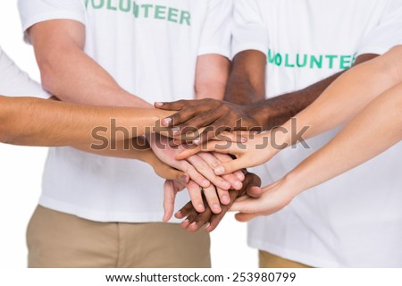 Teamwork with hands together standing on white background - stock photo