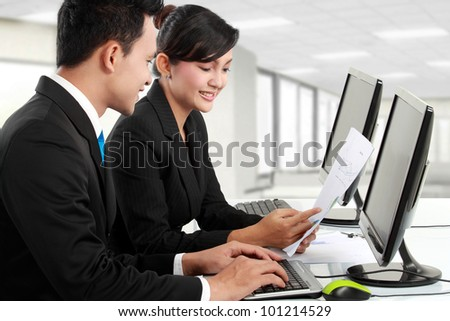 teamwork. woman and man working in the office - stock photo