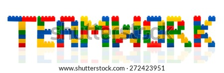 Teamwork word build from toy building block. - stock photo
